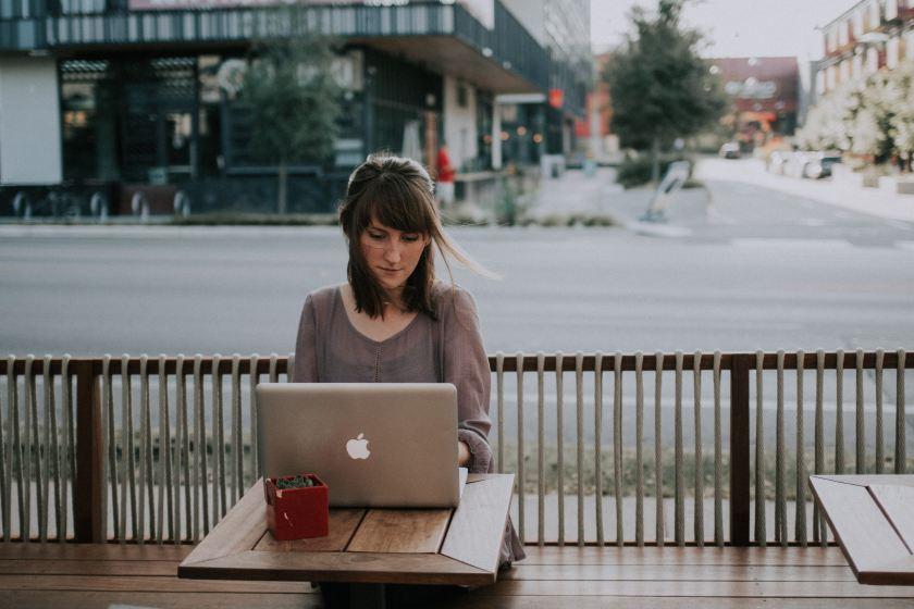 woman writing at coffee shop