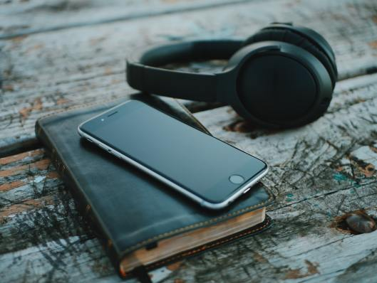 headphones, book and mobile phone
